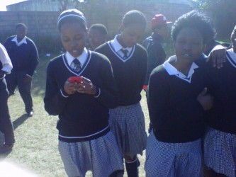 Girl receiving GRS SMS