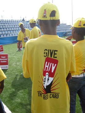 """A skillz participant wears one of our new """"Give HIV the Red Card"""" t-shirts and hats."""