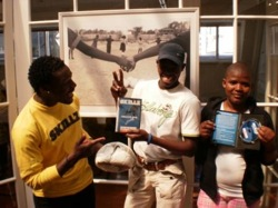 GRS' Cape Town Skillz Coaches, Phumla Dyonta, Thembinkosi Sikinya, and Andile Rafeni celebrate the arrival of the Skillz Coach's DVD