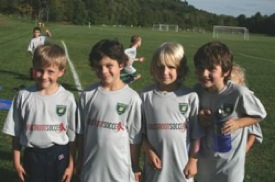 Members of the UV Lightning U8-U9 team proudly showing their support of Grassroot Soccer on opening day.