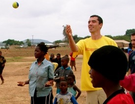 """Tommy Clark plays """"Juggling My Life"""" with Grassroot Soccer participants in Zambia on World Aids Day, 2006."""