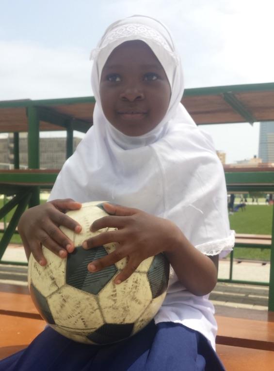 TZ girl holding ball