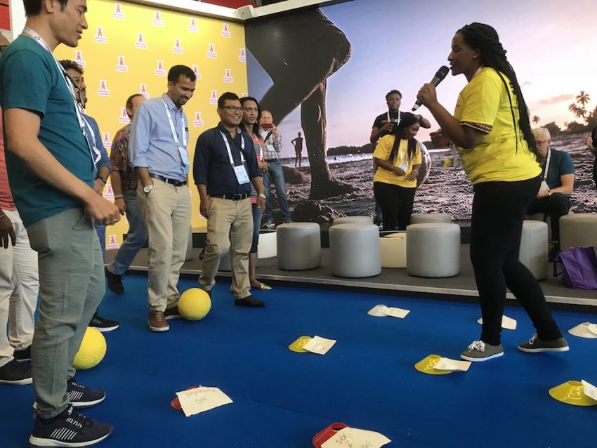 """AIDS 2018 delegates participate in """"Risk Field"""", a GRS SKILLZ activity, at the MenStar booth in the Global Village."""