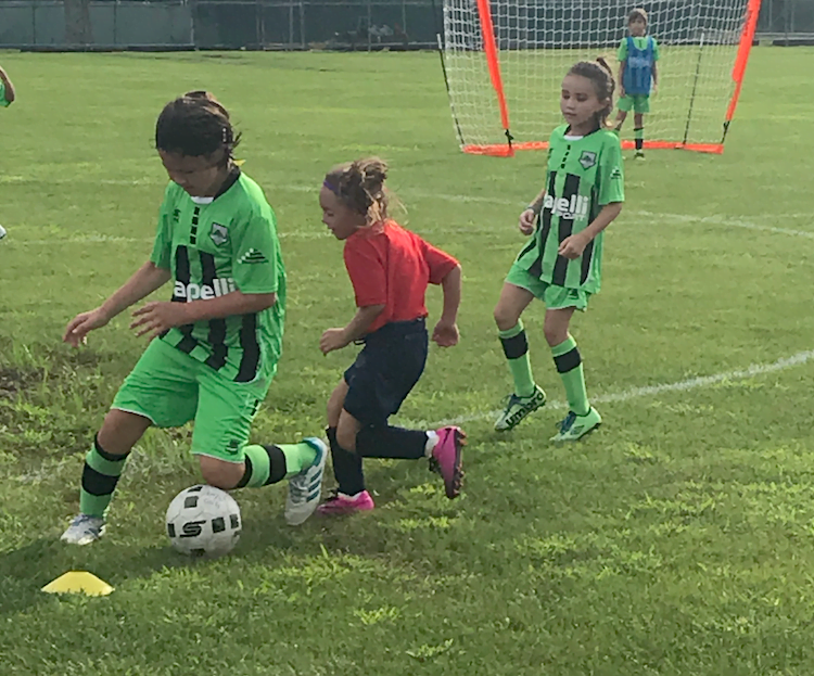EDP Futures & Grassroot Soccer Challenge Hosted by Sky Blue FC participants vie for the ball.