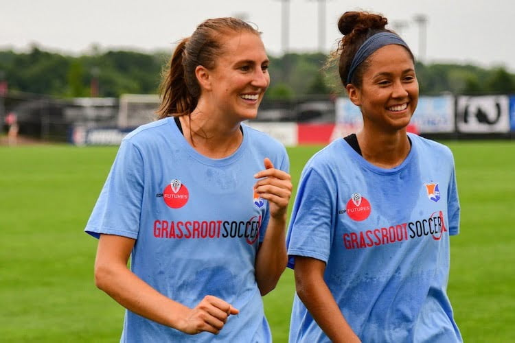 Sky Blue players warm up in Grassroot Soccer / EDP Futures / Sky Blue FC shirts