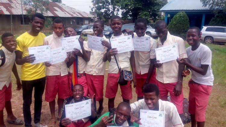 Graduates of the SKILLZ Guyz program and their Coach are all smiles in Lagos, Nigeria